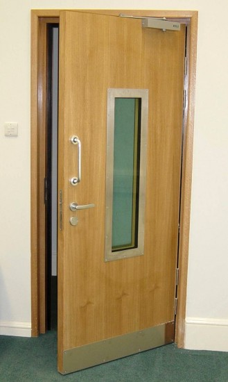 Security Door with Bullet Resistant Vision Panel and Electric Locking